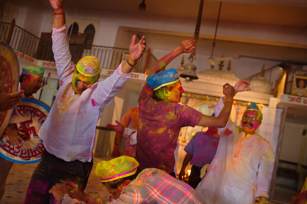 Bathed in colored powder, men celebrate India's spring festival of Holi, also known as the Festival of Colors.