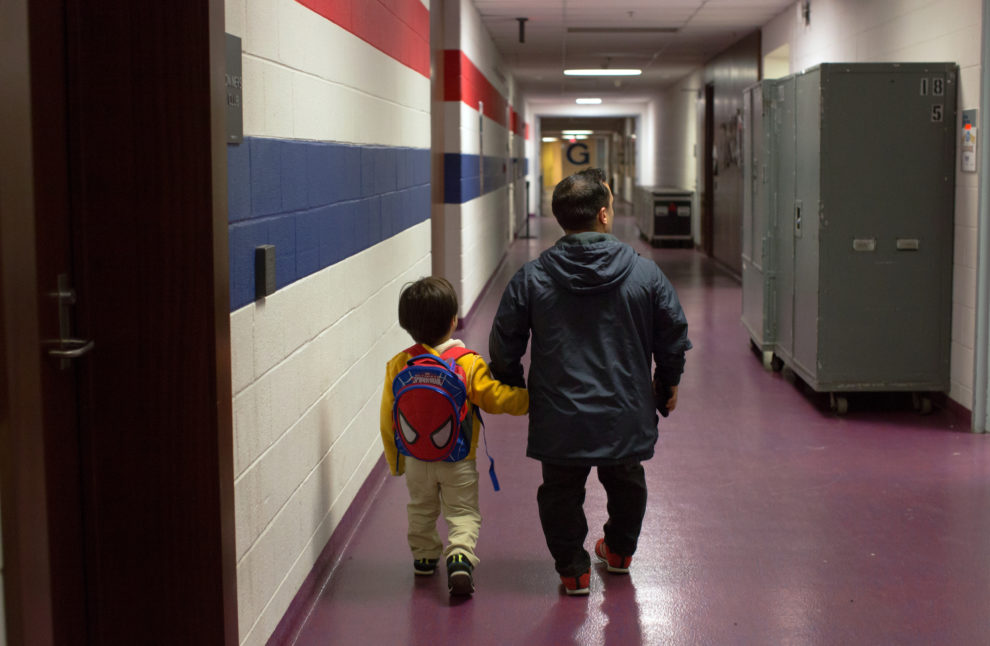 "Brazilian actor Paulo Cesar Oliveira dos Santos walks his son Kauile dos Santos, 7, to school inside the arena where they were performing in Washington D.C. The school travels with the circus and works from a homeschool curriculum. Ringling Bros. and Barnum & Bailey Circus started in 1919 when the circus created by James Anthony Bailey and P. T. Barnum merged with the Ringling Brothers Circus. Currently, the circus maintains two circus train-based shows, the Blue Tour and the Red Tour, as well as the truck-based Gold Tour. Each train is a mile long with roughly 60 cars: 40 passenger cars and 20 freight. Each train presents a different ""edition"" of the show, using a numbering scheme that dates back to circus origins in 1871 — the first year of P.T. Barnum's show."