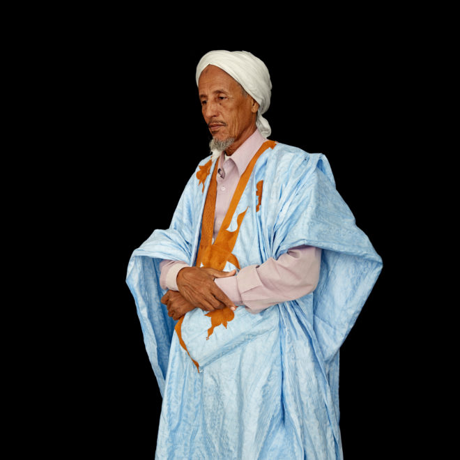 "Portrait of Hademine Ely, religious leader, Mauritania. Championing the rights of children comes naturally to Hademine Ely, a father of eight who was a primary school teacher long before he became the imam at a mosque in Mauritania's capital city, Nouakchott. ""For me . . . religion is against harmful practices, and all those practices, they are against religion, especially when we don't allow girls to go to school, especially when we force a young girl to get married,"" said Ely, who heads the Imams and Religious Leaders Network for Child Rights. ""My work is to clarify to people that child marriage is not part of our beliefs. It's a harmful practice regarding the girl. . . . Each thing that harms the body . . . is forbidden in Islam, so, that's why we as Muslims should forbid and eradicate child marriage and those harmful practices."" For a portrait series on champions leading to end child marriage in Africa. All images made at the first-ever African Girls' Summit on Ending Child Marriage, held in Lusaka, Zambia. The meeting aimed to facilitate exchange of good practices and challenges in ending child marriage, and to secure and renew commitments from African stakeholders."