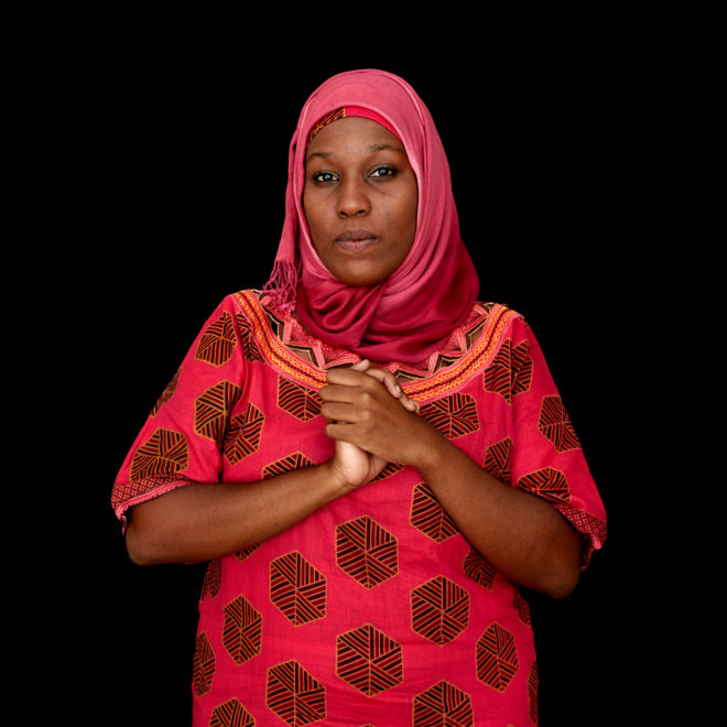 "Portrait of Amina Alliy. Amina Alliy isn't sure ""marriage"" is the right word to denote a union between a child and an adult. ""If a girl at the age of 15 is forced to be with an older man, it's not actually a marriage because a marriage is supposed to be an agreement between consenting adults,"" says Alliy, who works for a nonprofit NGO that campaigns against child marriage, gender-based violence and female genital mutilation. ""In this case, there is no consent. That cannot be a marriage. That is a misnomer."" Regardless of the verbiage, talking about the practice with a broad cross-section of stakeholders is key to eradicating it, said Alliy. That means engaging with government and traditional leaders, men and women, civil society, everyone from senior citizens to young people. In Tanzania, girls can legally marry at the age of 15 and some 37 percent of them are brides before their 18th birthdays. Lawyers need to toughen those laws, and locals need to follow them, she said. ""It should be a partnership where everybody's involved,"" she said, adding that political will is important but ""it has to carry the cooperation of the people as well. And this is the key to all this campaign."" In an effort to educate communities about the widespread dangers associated with child marriage and encourage them to halt the practice, the African Union launched its Campaign to End Child Marriage in Africa in 2014. Since then, the effort has attracted a burgeoning roster of child advocates, from government officials and religious authorities to traditional leaders and former child brides—all bent on serving as champions of change in Africa."