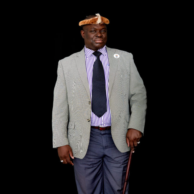 """Portrait of Chief Madzimawe of the Ngoni speaking people in Chipata, in the Eastern Mwenda Chikankata of the Eastern Province of Zambia. Retrieving young girls from forced marriages remains a large problem in the Eastern Province, said Chief Madzimawe, but even more troubling is the lack of """"safe houses"""" to bring them to once they've been rescued. As an example, the chief noted that in October 2015, his own mother gave shelter to a young escaped bride because she had nowhere else to go. He said he'd like to see community-run shelters established in every sub-district, where girls could find a safe haven and receive counseling. """"They need counseling so that they are integrated back into the community fully counseled, and they are not going to feel as if they are different species from another planet,"""" he said. If you send them back to their families """"haunted by household poverty,"""" nothing will change, he said. For a portrait series on champions leading to end child marriage in Africa. All images made at the first-ever African Girls' Summit on Ending Child Marriage, held in Lusaka, Zambia. The meeting aimed to facilitate exchange of good practices and challenges in ending child marriage, and to secure and renew commitments from African stakeholders."""